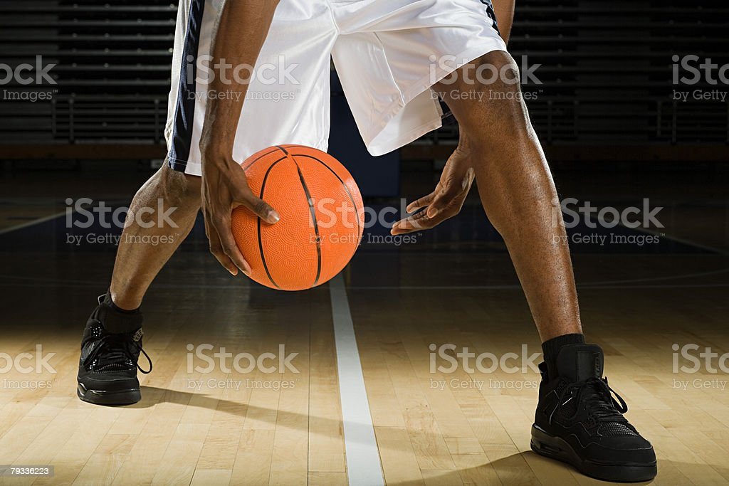Legs of a basketball player stock photo
