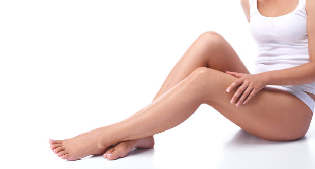 Legs of a beautiful girl on a white background stock photo