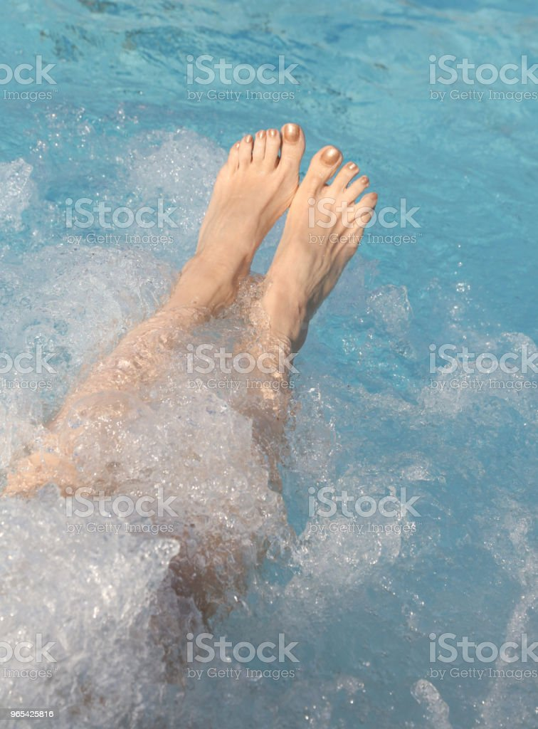 legs of a lady massaged by the water of the whirlpool royalty-free stock photo