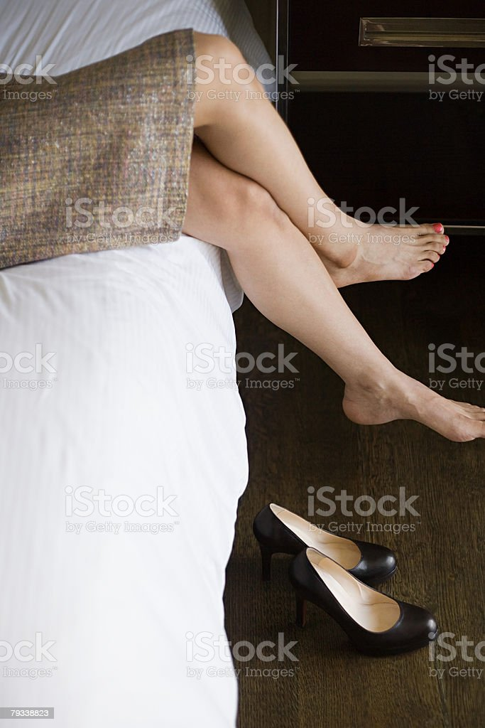 Legs of a woman on bed royalty-free 스톡 사진