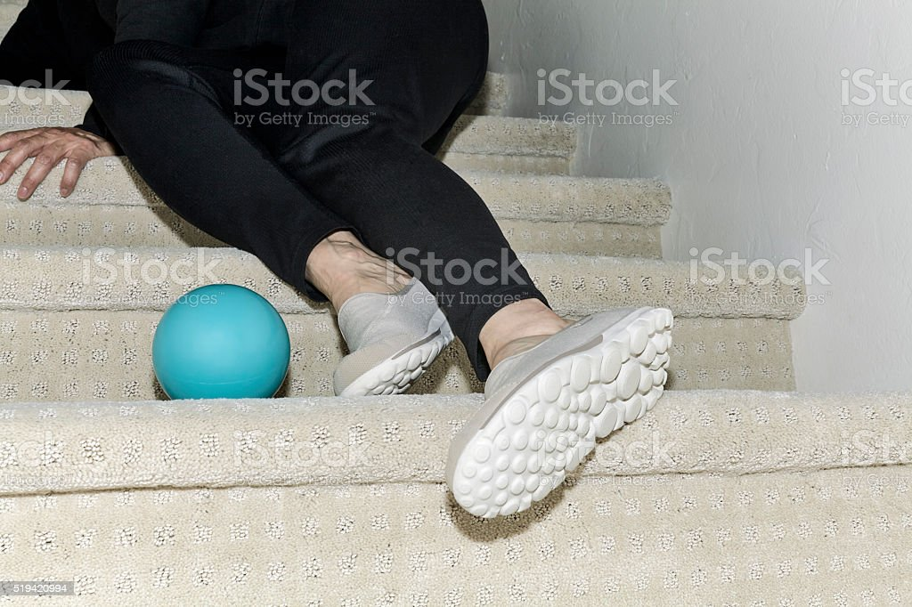 Legs of a Woman who fell on the Stairs stock photo