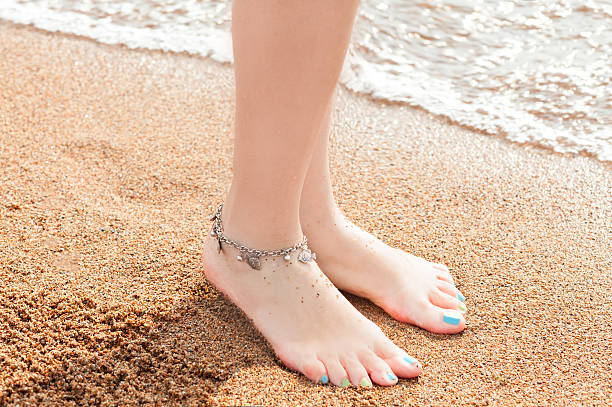 legs of a young girl and anklet ankle stok fotoğrafı