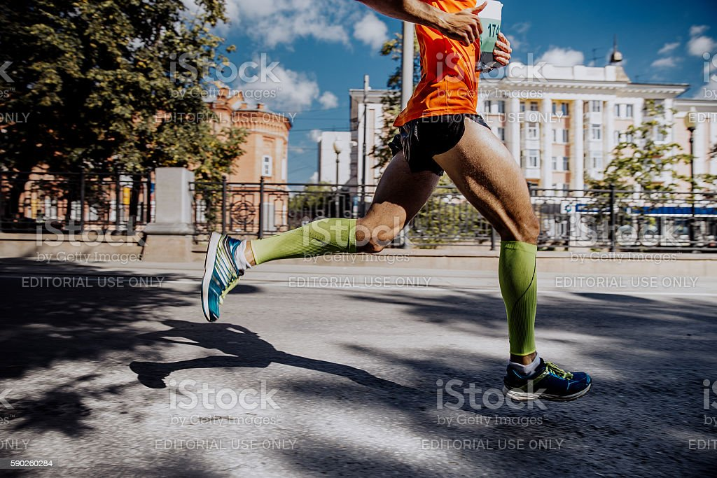 legs of a young male athlete stock photo