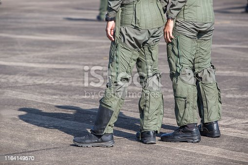 istock Legs of Air Force pilots. Pilots who are in preparation for flight training on military airbase 1164149570
