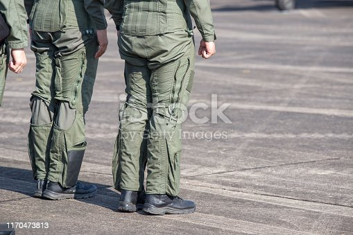 istock Legs of Air Force pilots. Pilots who are in preparation for flight training on military airbase 1170473813