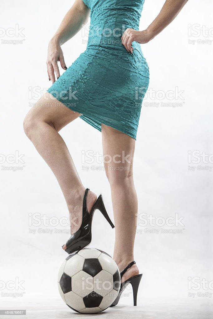 Legs of an attractive soccer mom stock photo