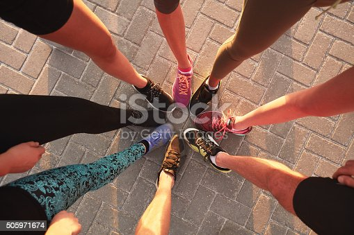 istock Legs of athletes in a circle 505971674