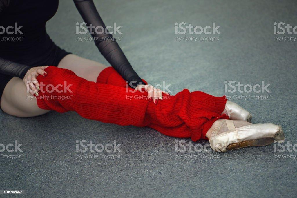 Legs of ballerina in leggings pointe shoes closeup stock photo
