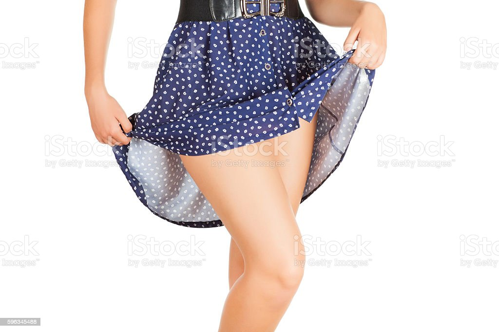 Legs of beautiful model covered with short preaty skirt. royalty-free stock photo