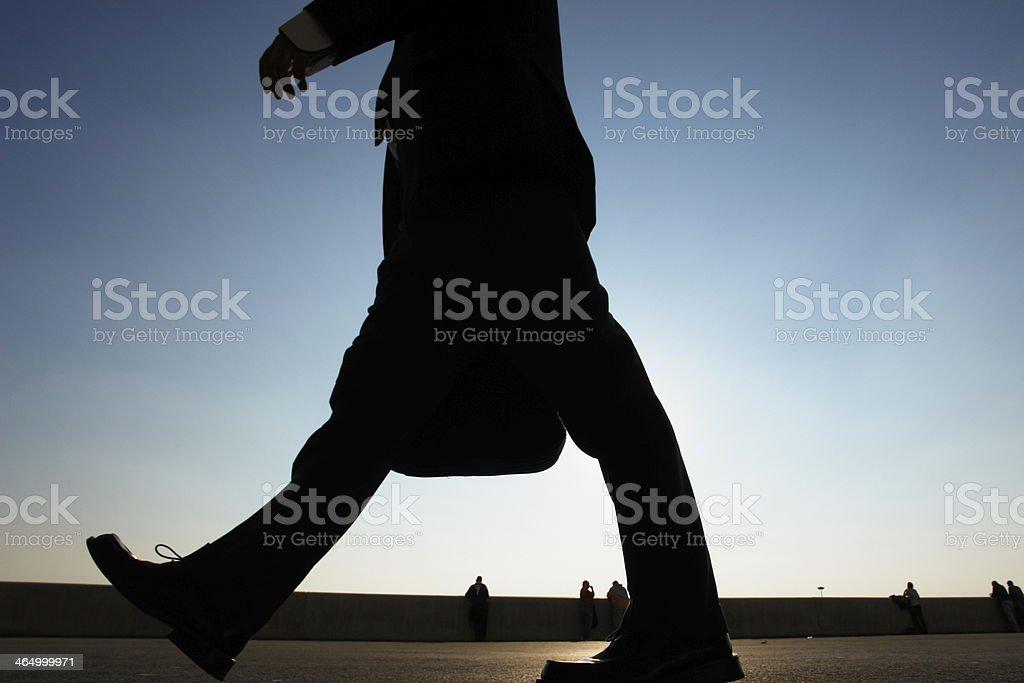 legs of business people walking stock photo