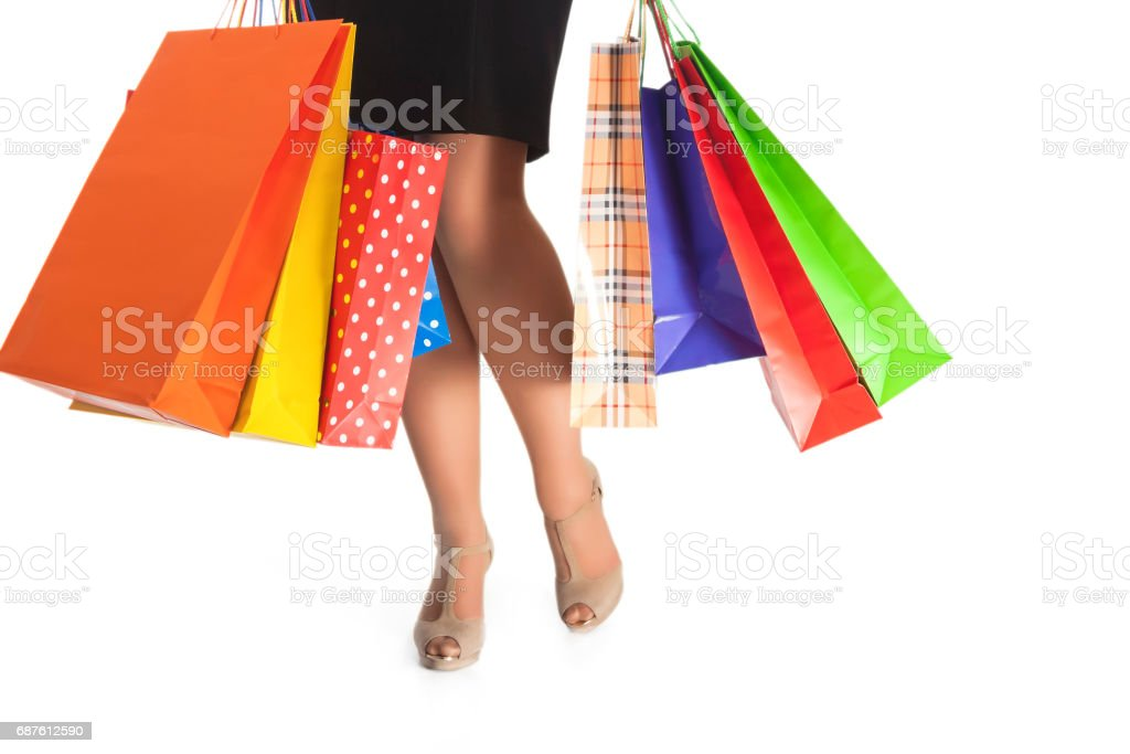 Legs of Caucasian Woman Holding Lots of Shopping Bags Isolated stock photo