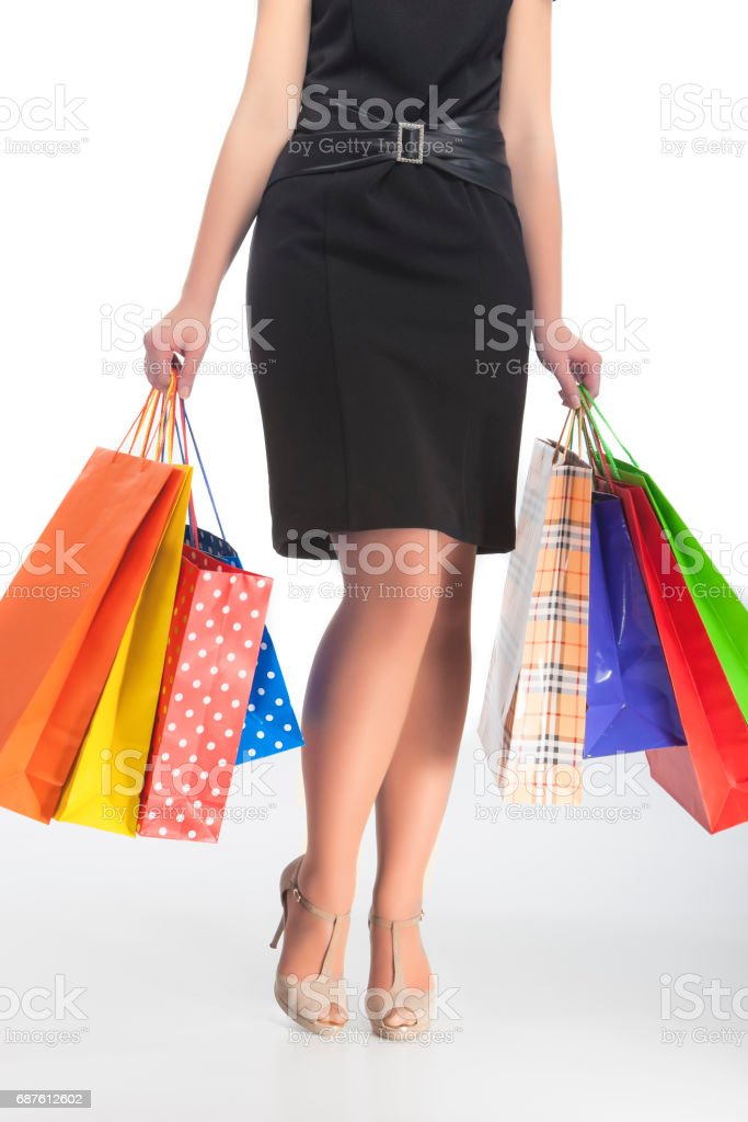 Legs of Caucasian Woman Holding Lots of Shopping Bags stock photo