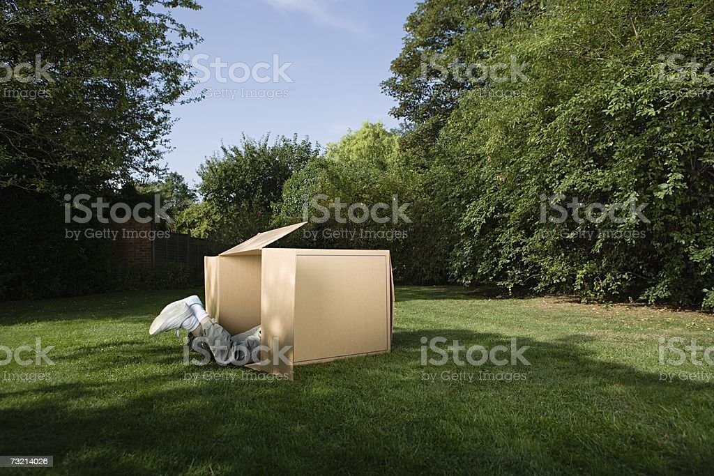 Legs of child in cardboard box royalty-free stock photo