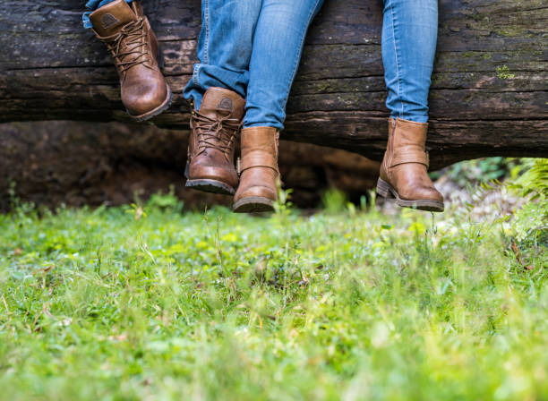 Legs of couple in love in park stock photo