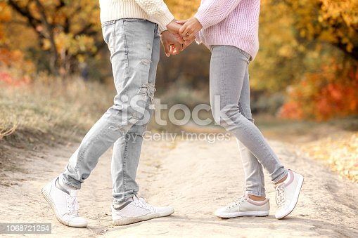 legs of couple in love kissing outdoor in autumn