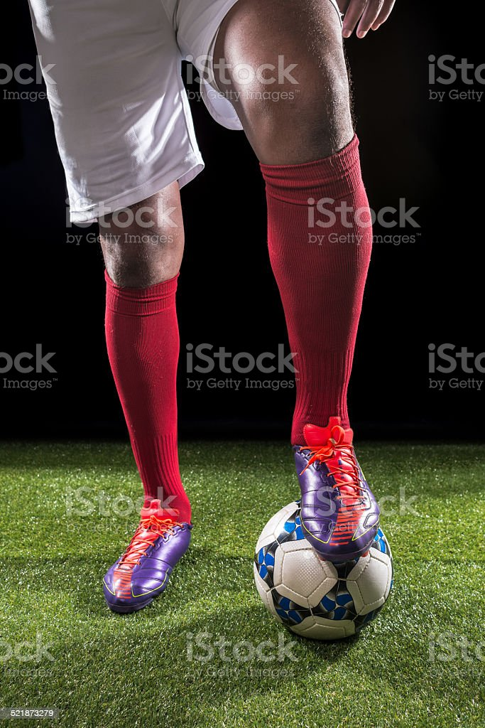 Legs of footballer stock photo