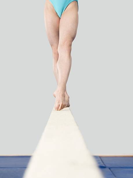 legs of girl on a balance beam - balance beam stock photos and pictures