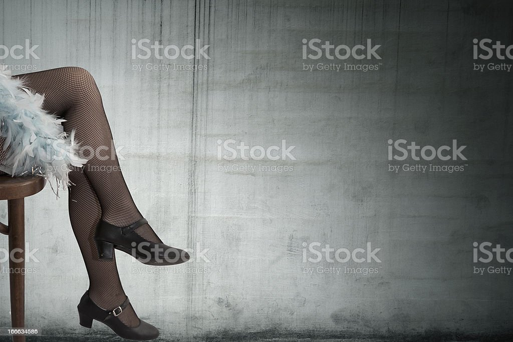 legs of girl with wall background stock photo