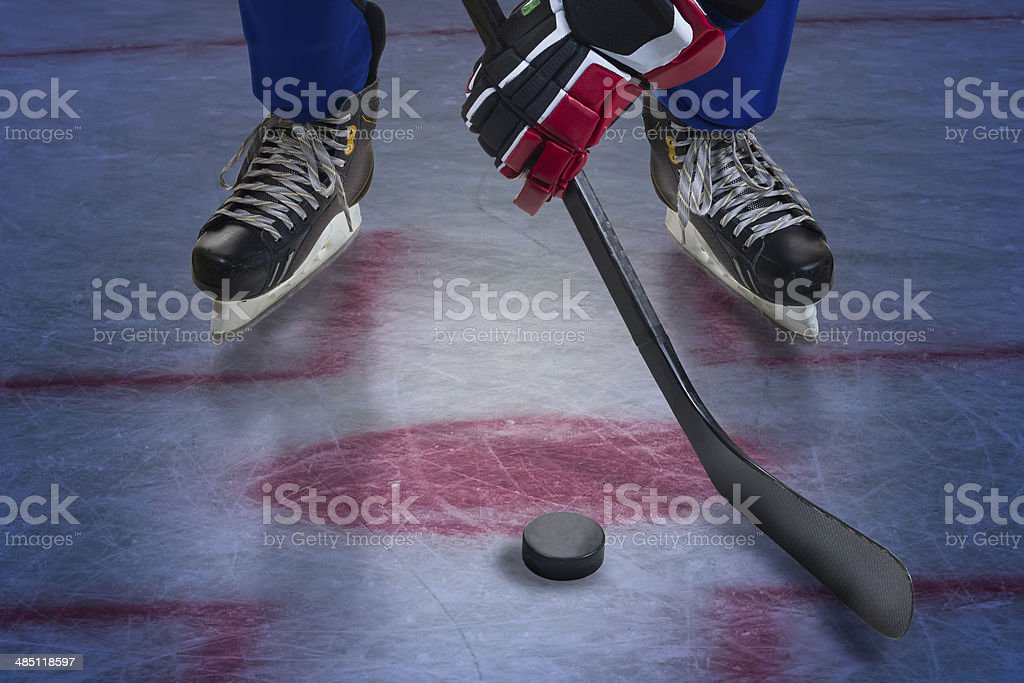 Legs of hockey player. stock photo
