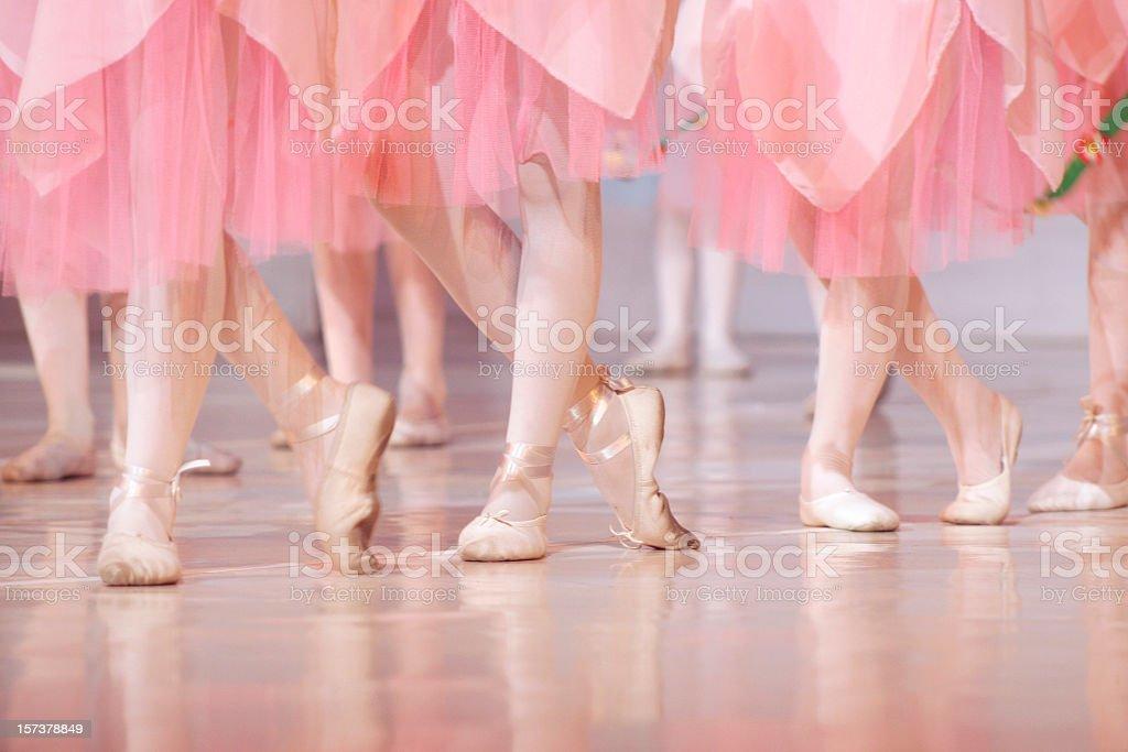 Legs of little ballerinas - balet background stock photo