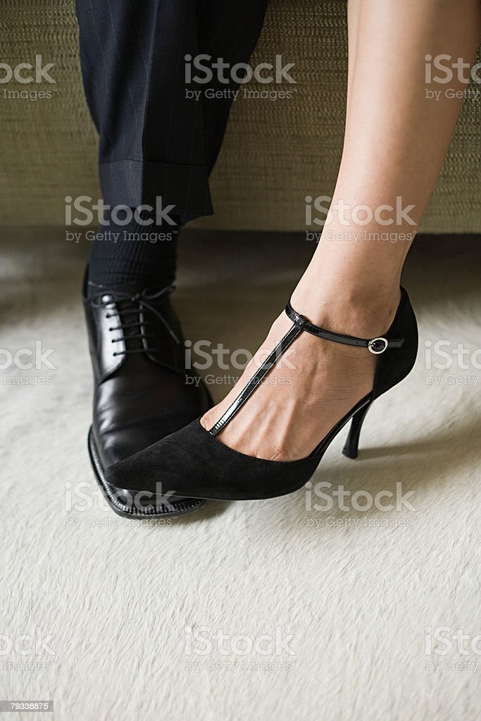 Legs of man and woman 免版稅 stock photo