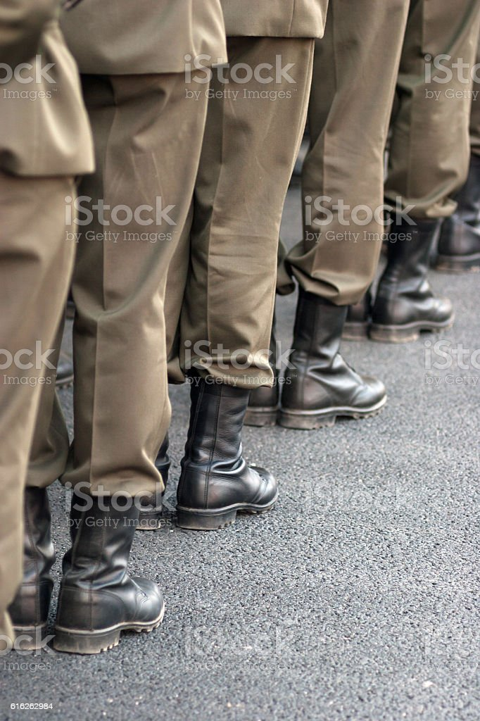 Legs of soldiers close up. stock photo