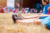 istock Legs of teenagers, music festival, in front of stage 531928896