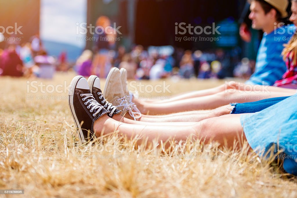 Legs of teenagers, music festival, in front of stage stock photo