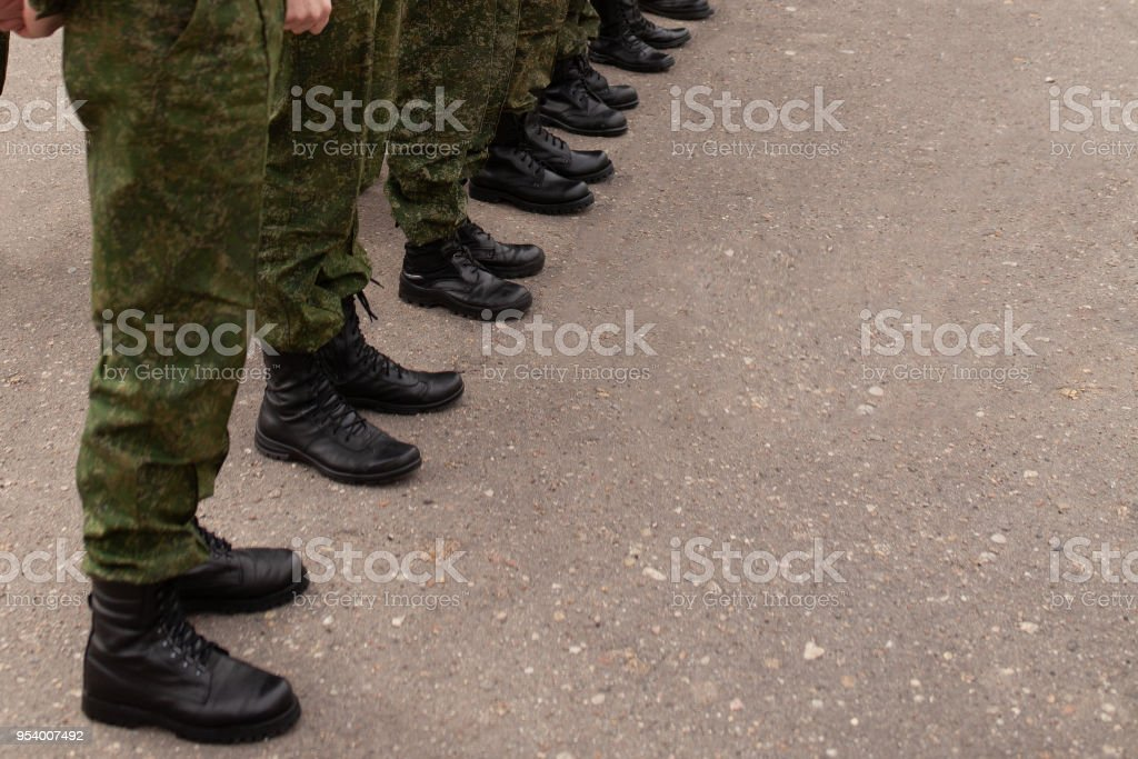 Legs of the military in the ranks stock photo