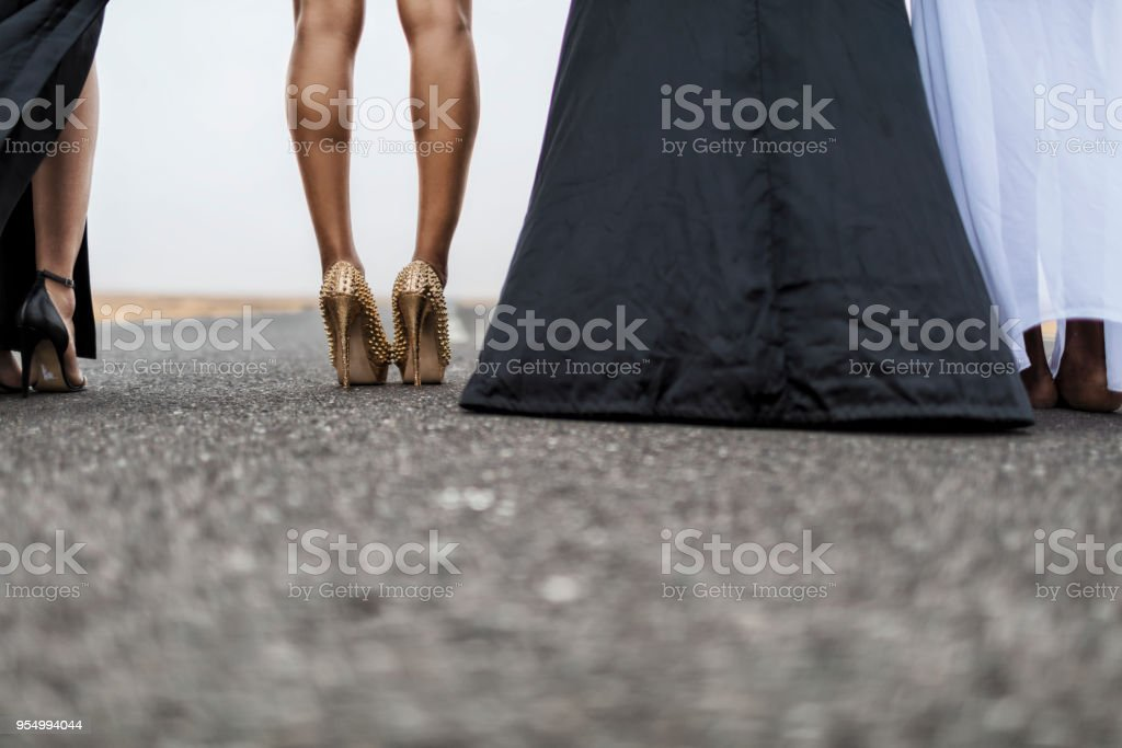 Legs of woman on asphalt road with fashion shoes. stock photo