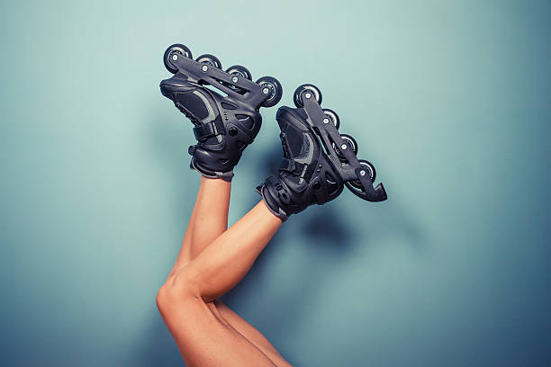 Legs of woman wearing rollerblades stock photo