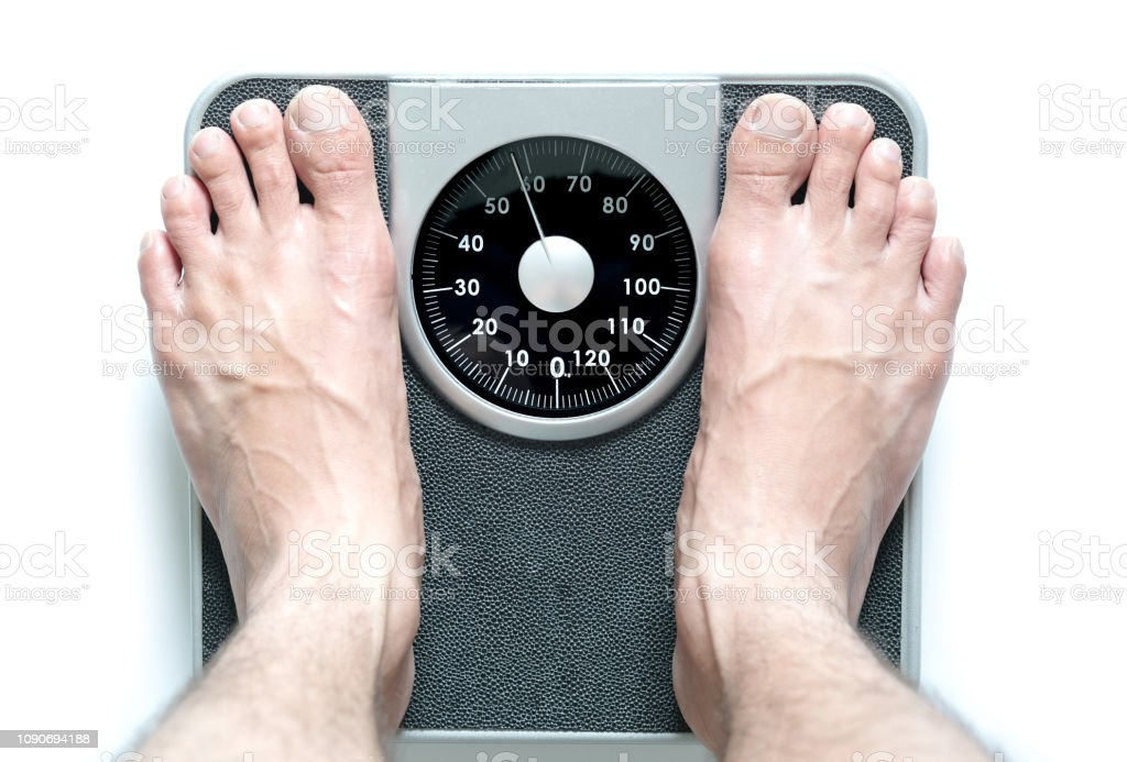 Legs of women standing on scales weight background fitness room. Concept of healthy lifestyle and sport stock photo