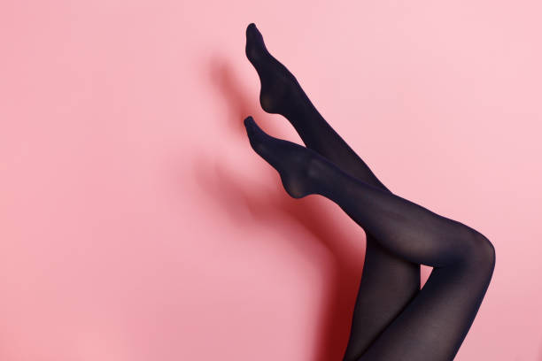 legs of young caucasian woman in black tights - black women wearing pantyhose stock photos and pictures