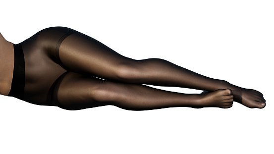 Legs of young woman in black tights, stockings, pantyhose. White background. Cut out.