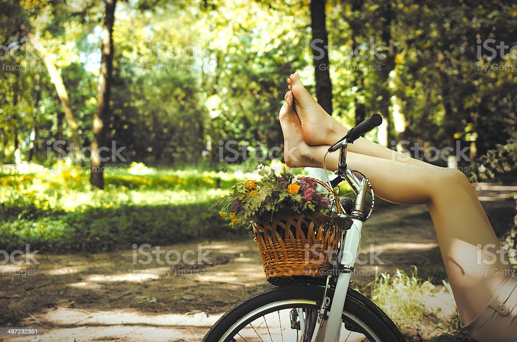 Legs on a bicycle stock photo