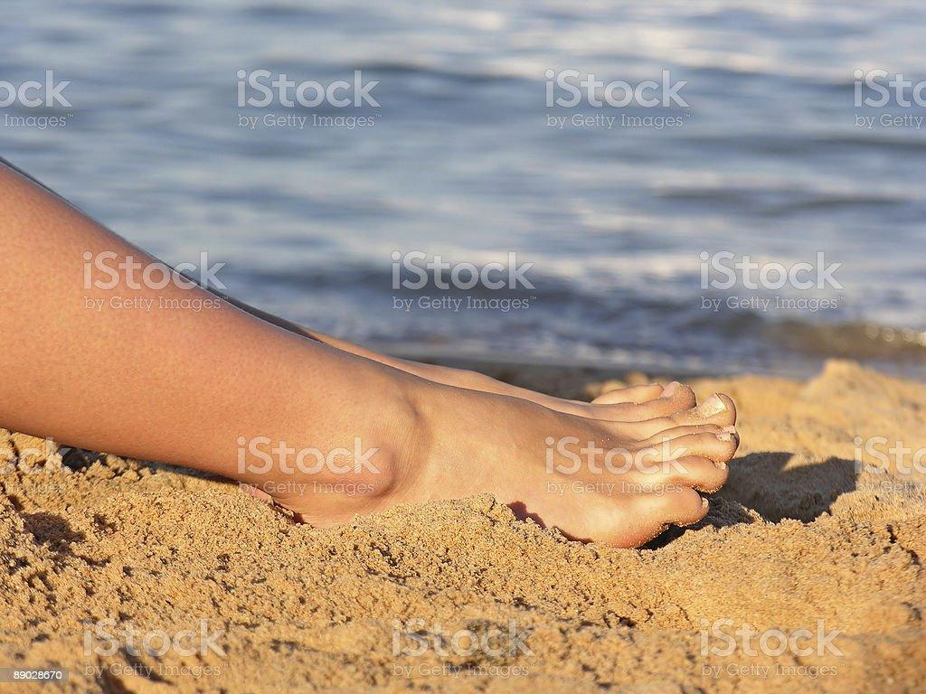 Jambes sur la plage photo libre de droits