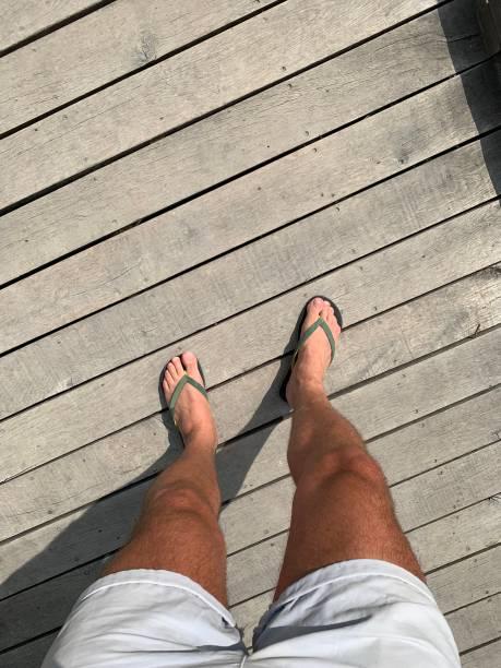 Legs on deck. stock photo