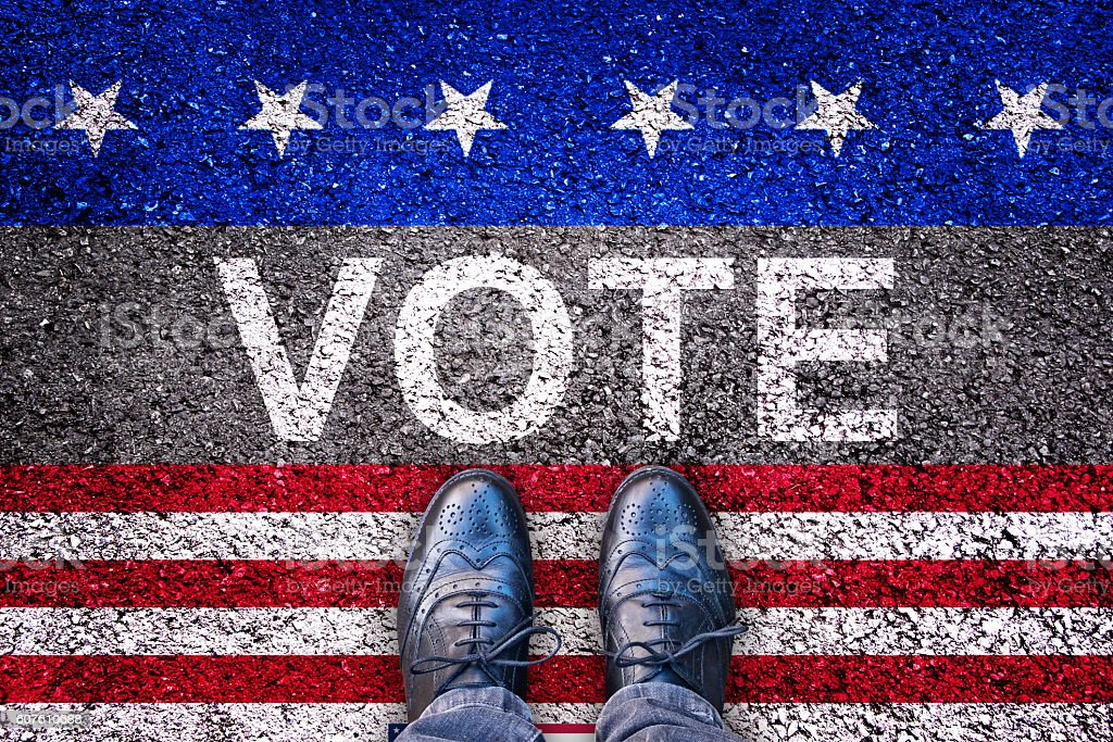 Legs on road with the word vote, american election concept stock photo