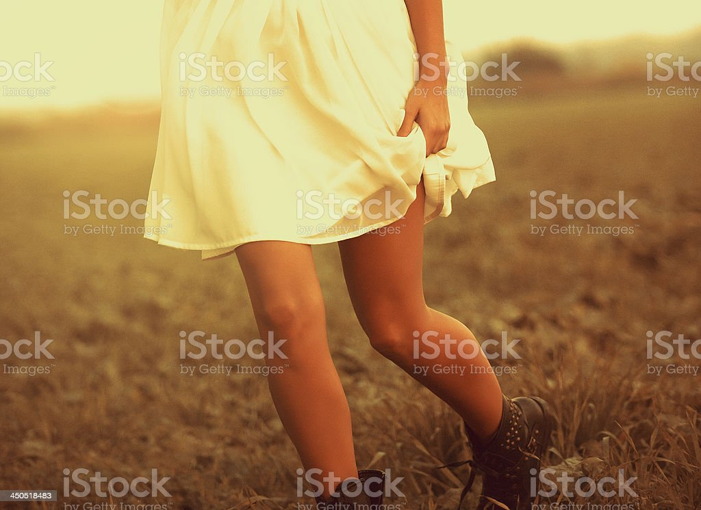 Legs runing in meadow - late sunset stock photo