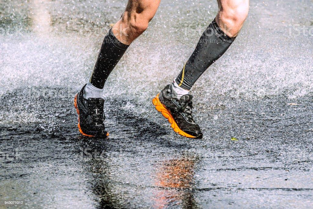 163cd18ea2 Legs runner athlete in black compression socks running water - Stock image .