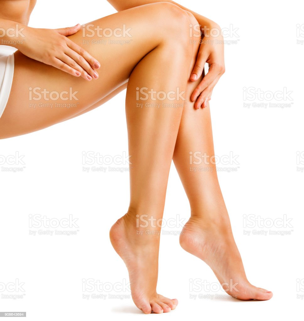 Legs Smooth Skin, Woman Touching Hairless Leg, Female Beauty Care and Hair Removal stock photo