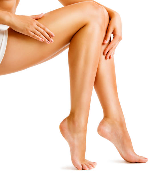 legs smooth skin, woman touching hairless leg, female beauty care and hair removal - human limb stock pictures, royalty-free photos & images