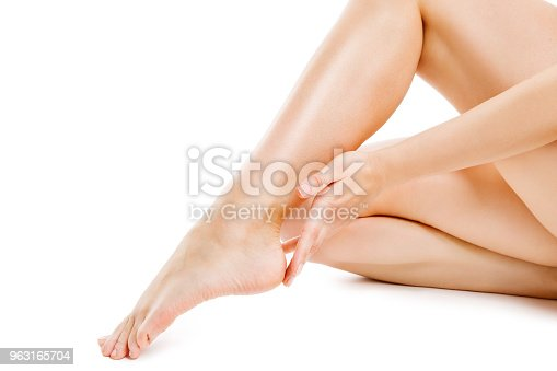 931733062 istock photo Legs Smooth Skin, Woman Touching Hairless Leg, Female Beauty Care and Hair Removal, Body White Isolated 963165704