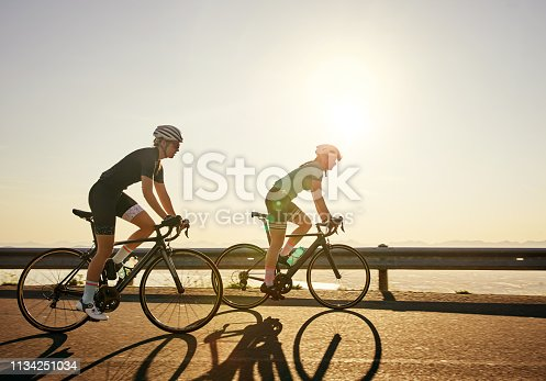 Shot of two sporty young women out cycling on a country road