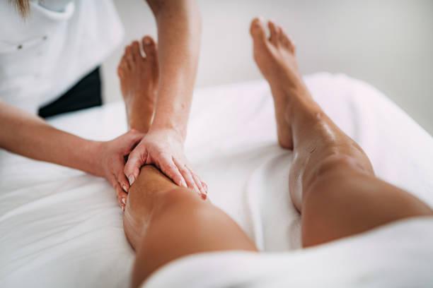 Legs Sports Massage Therapy stock photo
