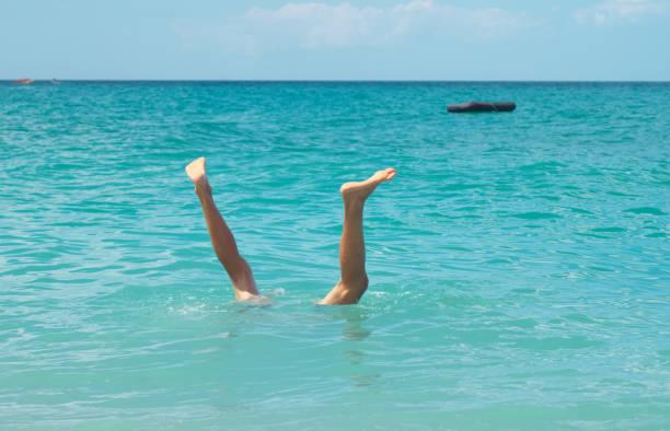 Legs under water. stock photo