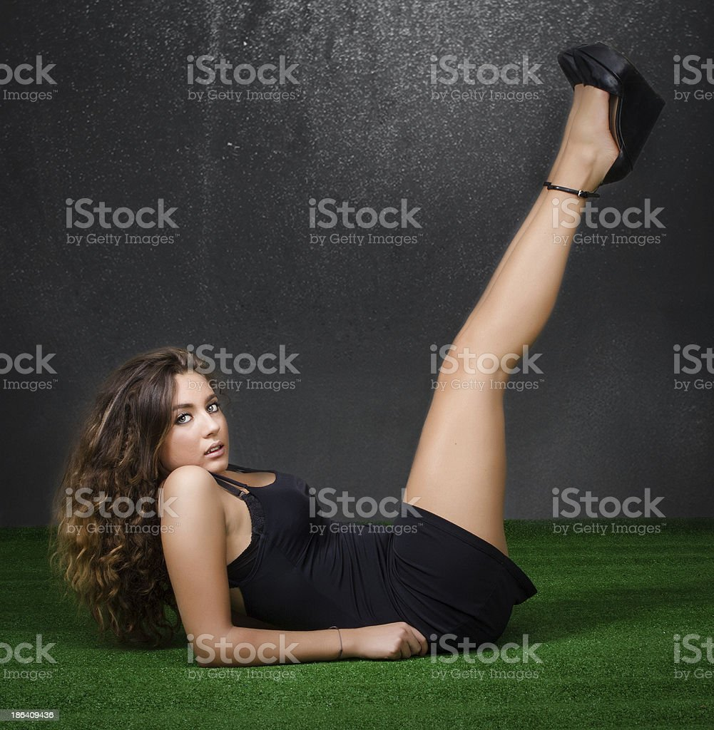 legs up and woman lying down stock photo