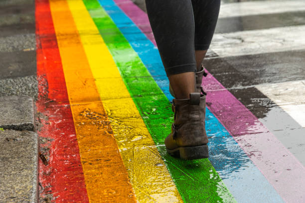 legs walking on gay rainbow crosswalk. - body parts of sexy girls stock pictures, royalty-free photos & images