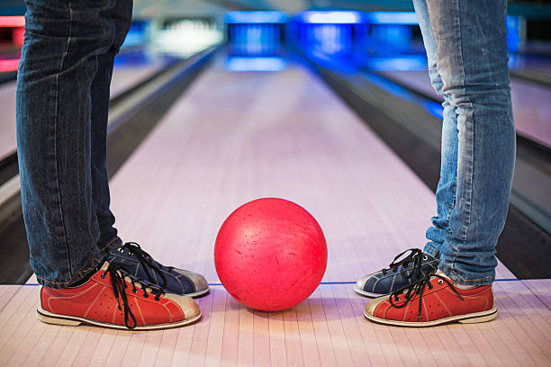 Legs with bowling ball. stock photo