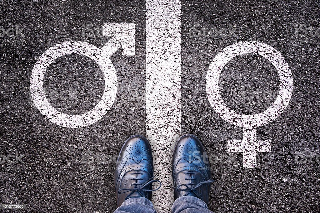 Legs with gender symbol on asphalt, gender concept stock photo